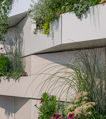 Sculpted 3D rainscreen metal panel systems Integrated planters and irrigation